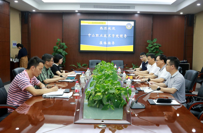 上海出版印刷高等专科学校、中山奥客网来访我院